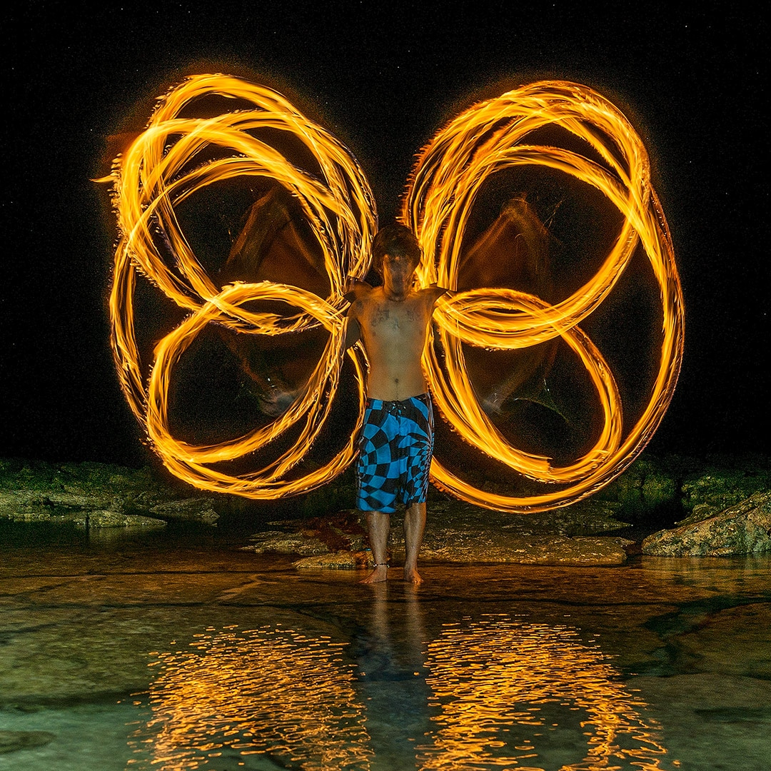 Fire dancer Kevin Jay Rama of Isla Kalayo (Fire Island) at Guyam island, Siargao Philippines. After shooting the Milky Way at Guyam island and taking some photos of Jay (fire dancer) at Viento del Mar, I want to improve my shot of both. Finally I came up with the idea to combine them and thus take Jay to Guyam.